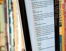 800px-EBook_between_paper_books